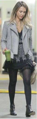 Jessica Alba wearing a printed dress and gray moto jacket