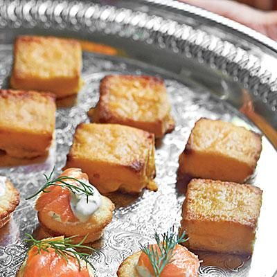 Cheese Dreams | These little gems will be the first appetizer to disappear. Make them the day before and refrigerate, or freeze up to 3 weeks. If frozen, pop in the oven straight from the freezer; increase the bake time by 10 minutes. | SouthernLiving.com
