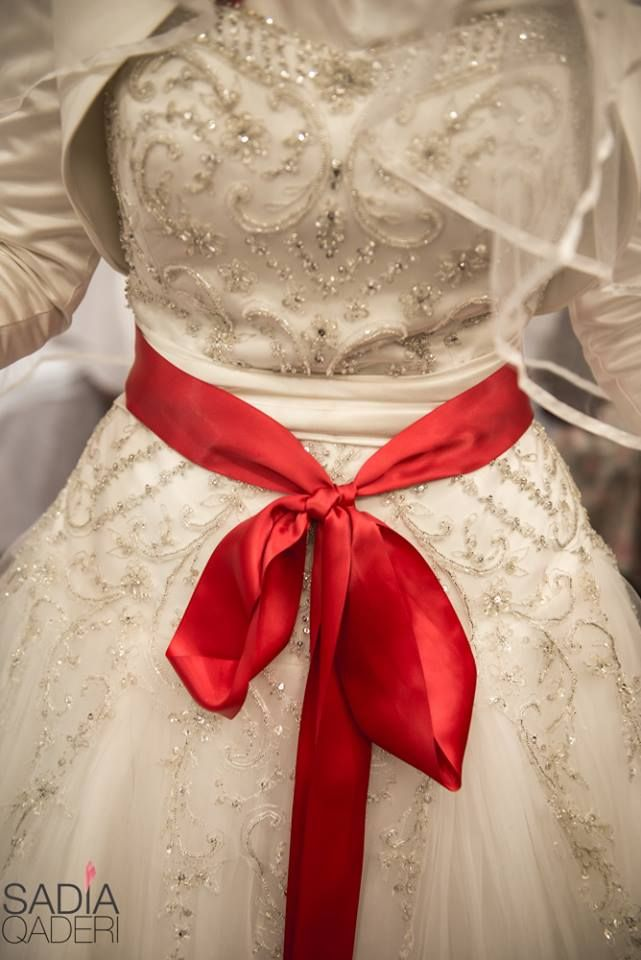 Turkish wedding, red bow/belt is a tradition
