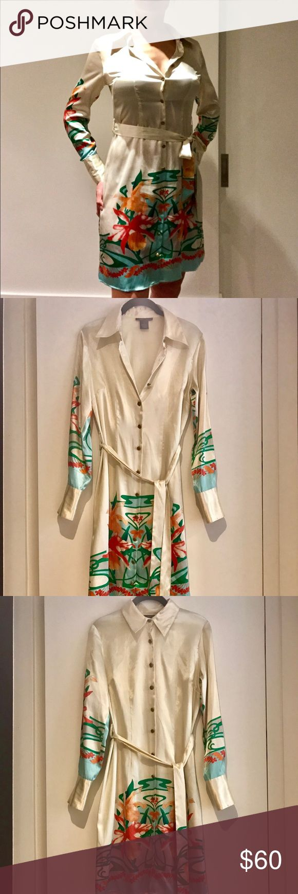 BCBGMAXAZRIA Belted Shirt Dress Effortless to transition from workweek to weekend, this long-sleeve shirt dress is designed with a eye-catching flower pattern and an attached adjustable waist-tie.  Condition: Like new! Worn once BCBGMaxAzria Dresses Long Sleeve