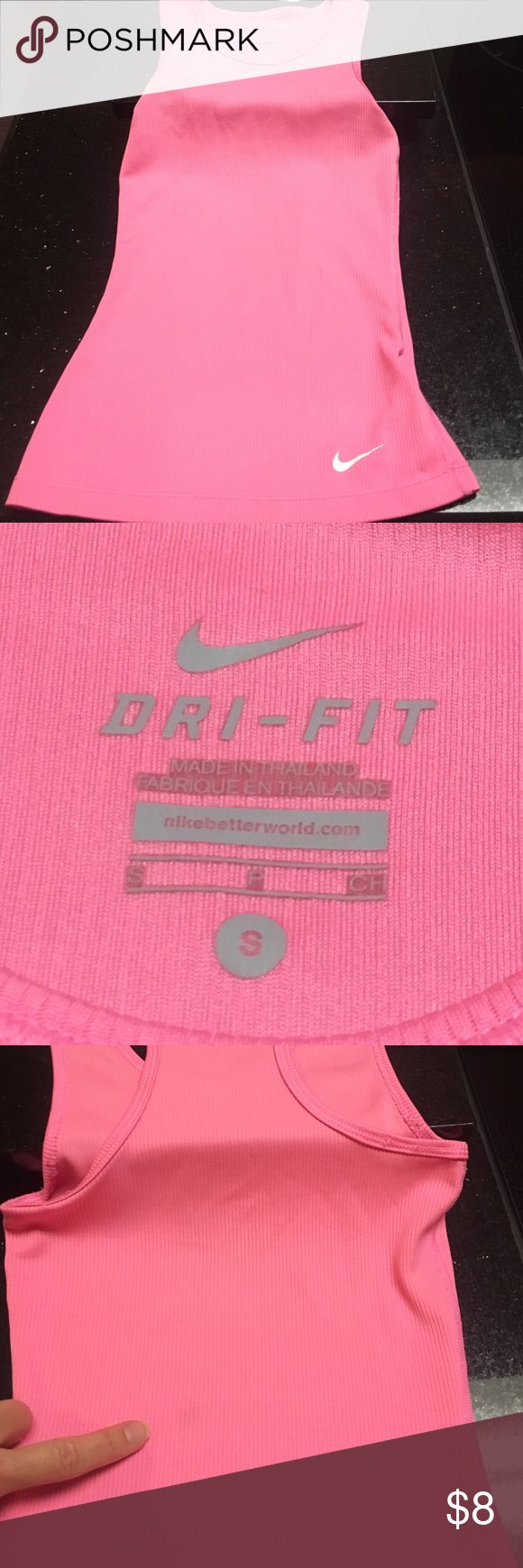 Bubble Gum Pink Nike Girls Dri-Fit Tank Size Small Girls Pink Racerback tank top, small dark spot on the back, may come out in wash? (Looks like something may have faded on it.) but still a great work-out top for Tennis/cheer/dance/workouts for young girl! Nike Shirts & Tops Tank Tops