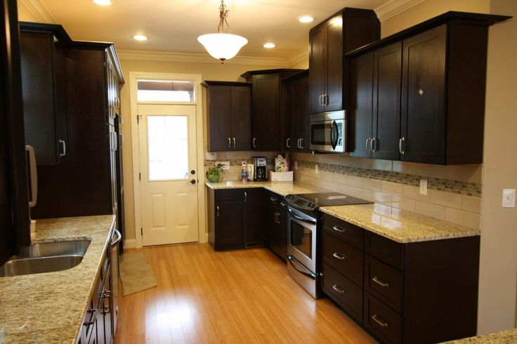 Espresso Cabinets With Light Hardwood And Matching