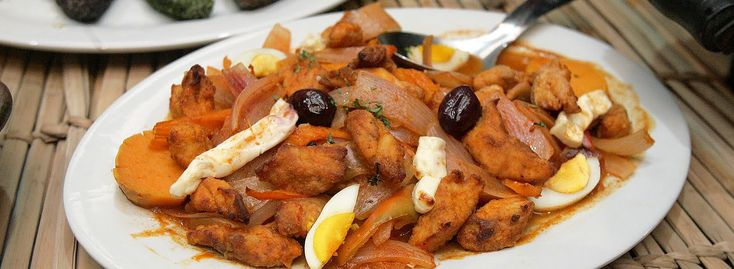 The Escabeche de Pescado is a delicious dish made with fried fish drizzled with a tart vinegar based onion sauce...