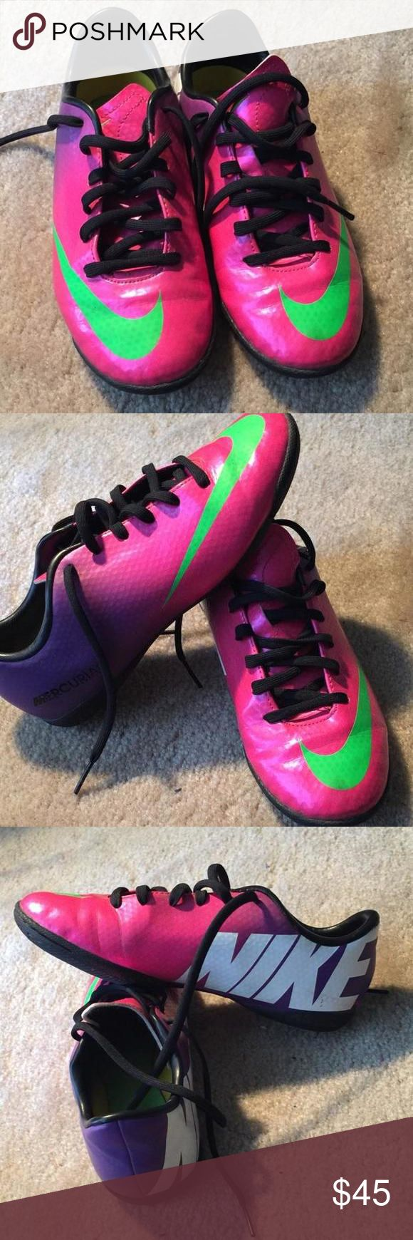 Nike soccer shoes Indoor soccer cleats by Nike. 2.5 youth. Neon pink, with neon Nike check. Back of the cleats are purple with white letters that say NIKE. My daughter wore twice and then decided for outdoor soccer instead. Nike Shoes