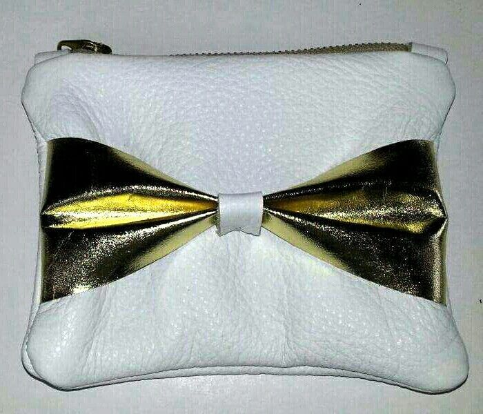 White leather clutch with gold bow detail