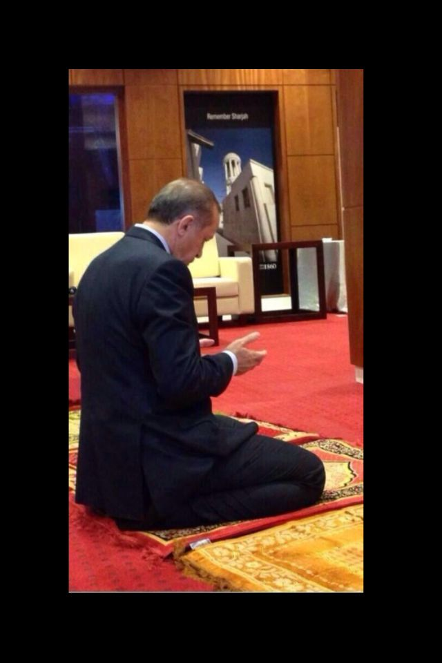 Recep Tayyip Erdogan ( prime minister of Turkey ,praying.