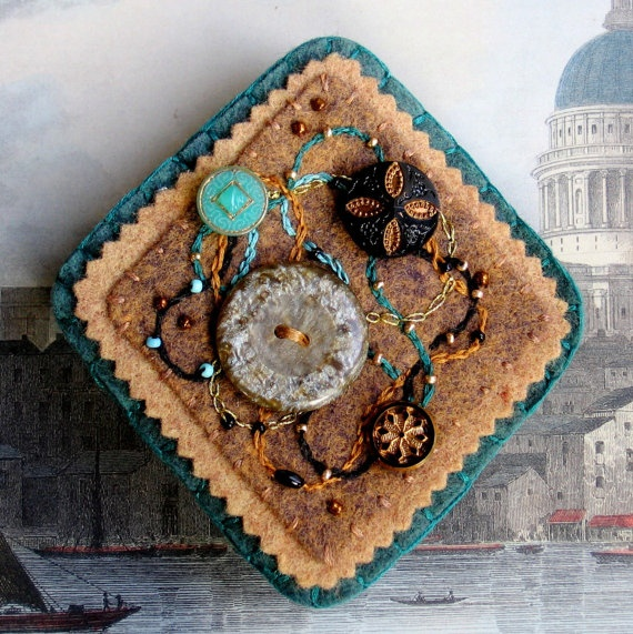 Victorian wool felt brooch with vintage buttons and embroidery. $50.00, via Etsy.