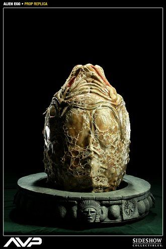 Alien Egg Prop Replica from Alien vs Predator. It is made by Sideshow Collectibles and is approximately 64 cm (25.2 in) high  http://alien-predator.minimodelfilmstuff.co.uk/alien-predator/alien-vs-predator-alien-egg-prop-replica-sideshow-collectibles-400094 From the 2004 release Alien VS Predator comes the Alien Egg Prop Replica, a full-scale reproduction of the Queen Alien's spawn. Measuring over two feet high, each piece is individually painted and finished, each with its own...