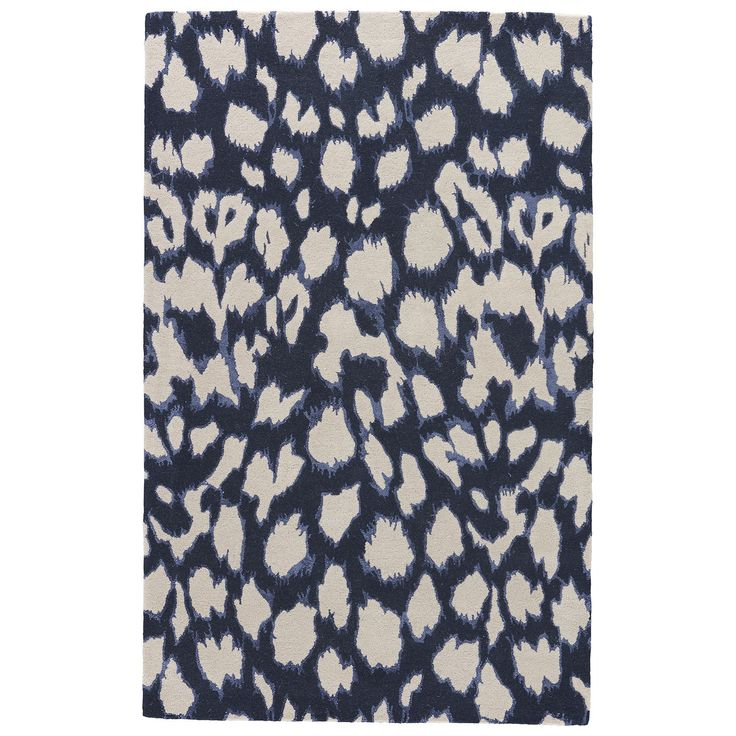 a contemporary take on animal print, this dark navy wool and silk hand-tufted rug gives any room a bit of a wild side.