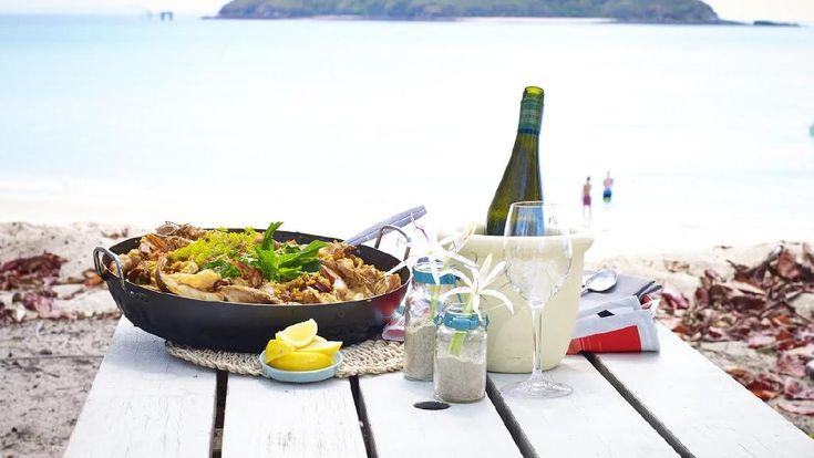 Chef Fast Ed's beautiful seafood paella with Moreton Bay bugs, snapper, squid, prawns and chorizo.