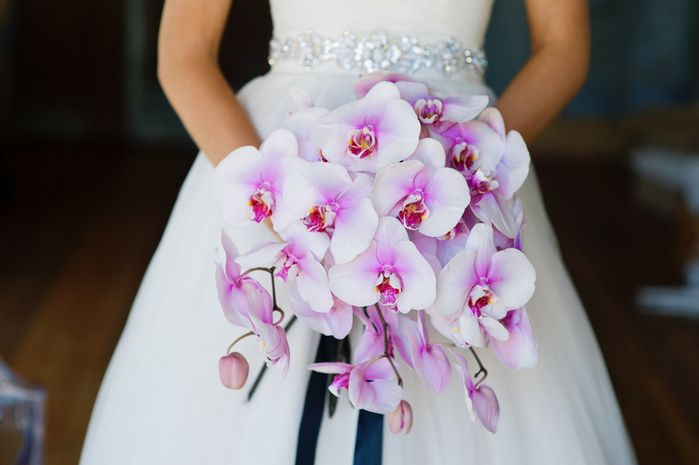 A breathtaking fuchsia and white phalaenopsis orchid wedding bouquet {Jenna Leigh Photography}