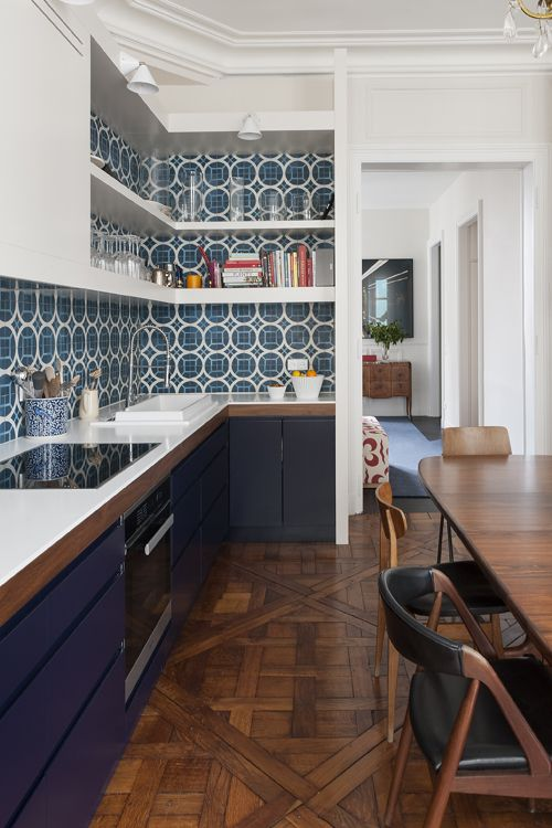 View from the kitchen to the Entrée, with Aretti lighting, Popham Design tiles, a bespoke corian countertop, a brazilian rosewood table from the 1960s, and a mix of vintage Danish chairs