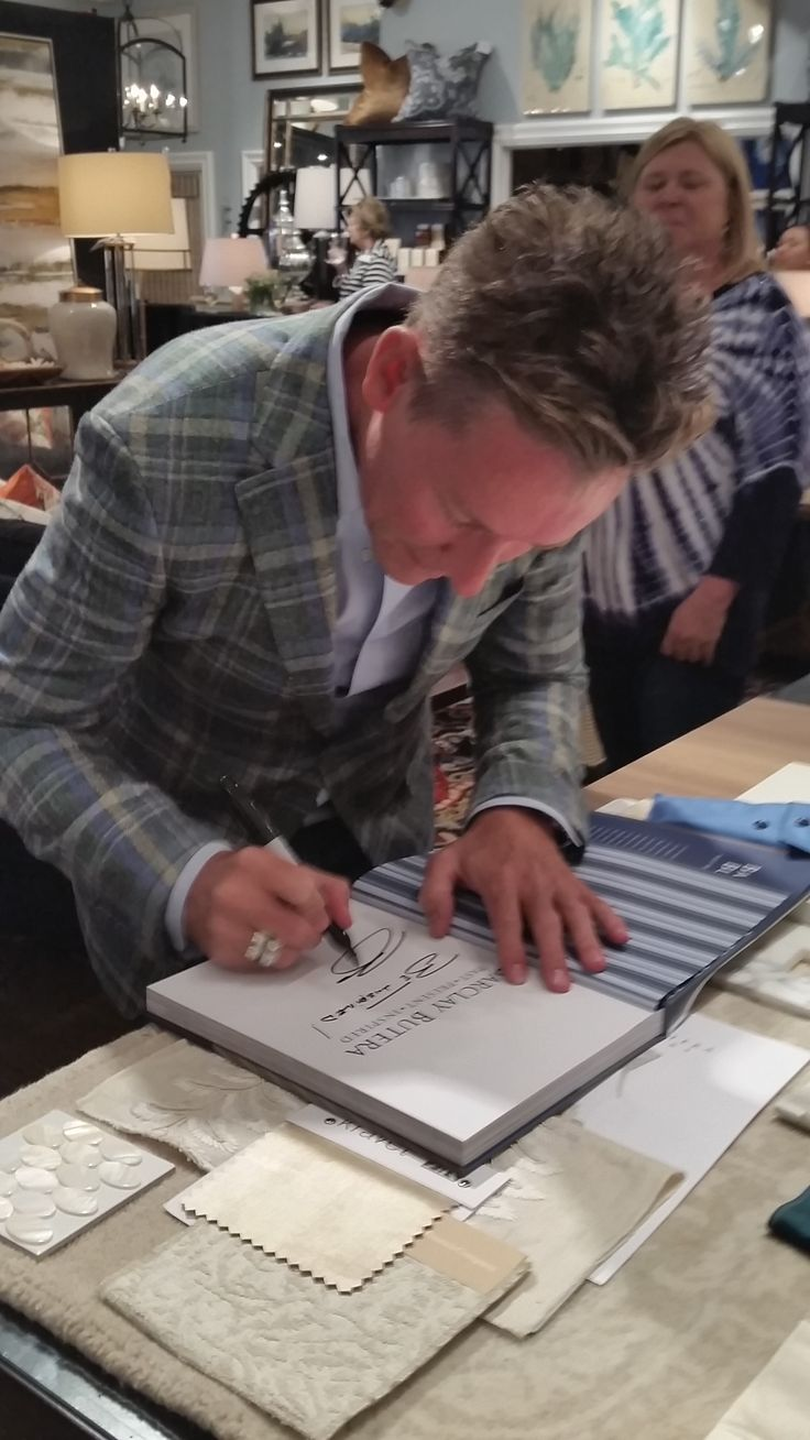 Barclay Butera signs book at the Newport harbor high home tour reception 2015. Pandor Bakery was there to offer sweets.