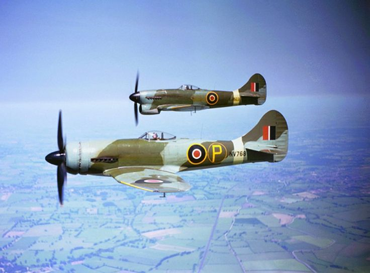 """This pair of Mk. V Hawker Tempest's  demonstrate the two different power plants tried out. Nearest is an experimental machine fitted with an annular radiator for its Sabre engine, while EJ 823 was a standard in service version with a Napier Sabre engine with the well known """"beard"""" radiator."""