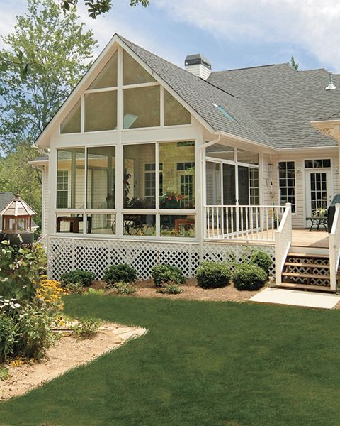 Love the high wall of windows in this sunroom... attached deck is nice too.