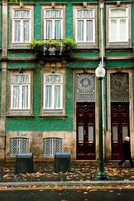 Painted teal brick and burgundy doors - Portugal.