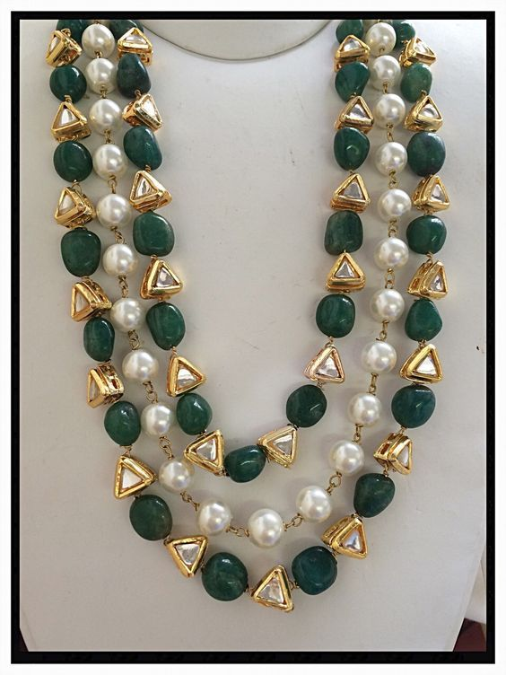 Emerald and Pearls Necklace with multi layers. Emerald beads are used alternatively along with uncut diamonds in two layers and pearls layer is in between.