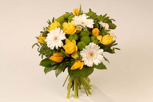 Fresh cut flowers - delivered in cellophane with ribbon.  Many color options available