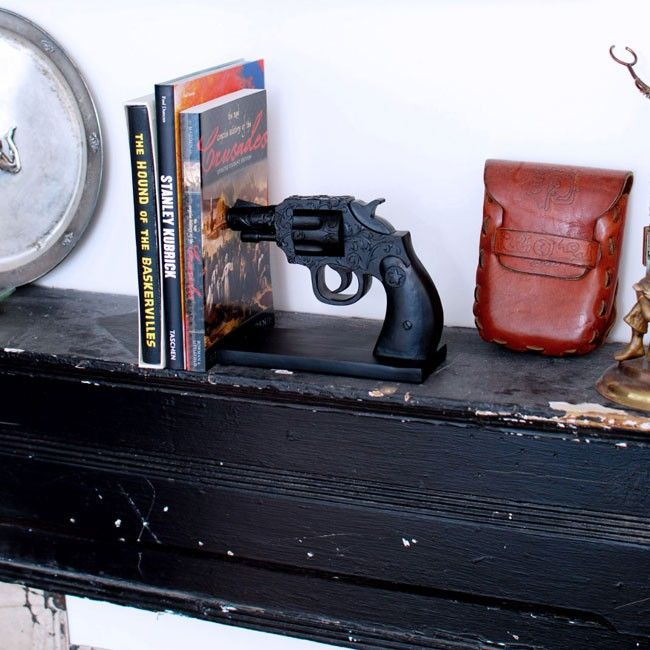 Toughen up your mantelpiece and show off your books in style with this intricate black revolver bookend. Sold individually. | huntingforgeorge.com