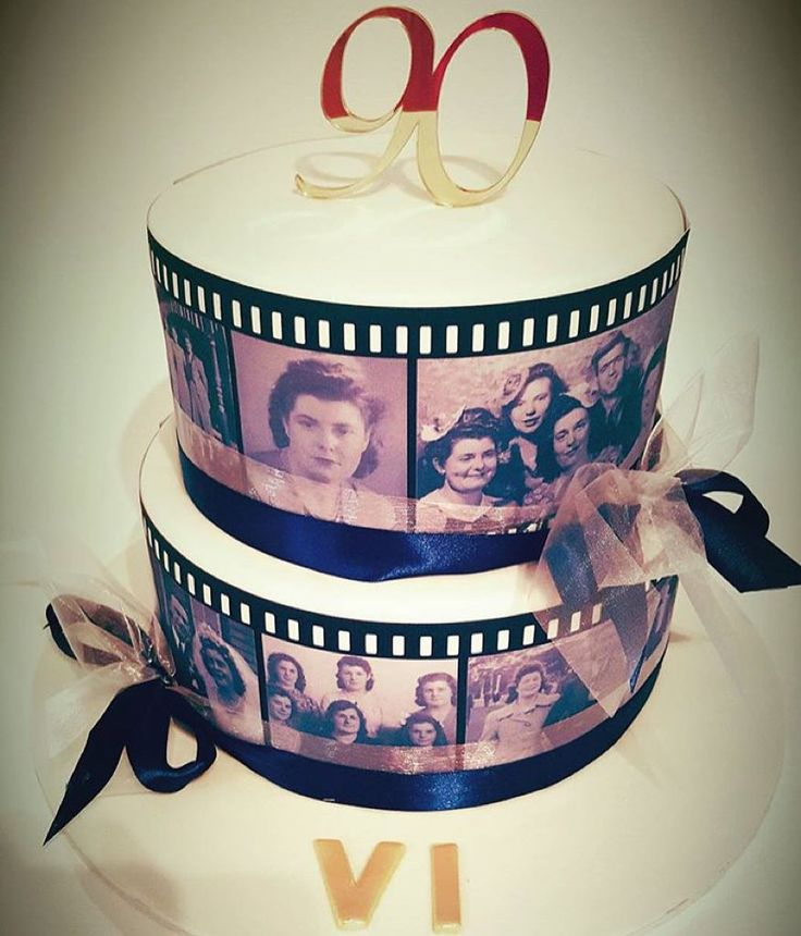 We love this tiered 90th birthday cake from @allabouticing with edible image filmstrips wrapped around the outside. See the best Edible Image Designs posted daily at http://topperoo.com/edible-image-designs/
