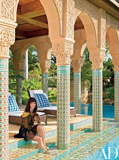 Webb sits on the pool steps with Hercules   archdigest.com