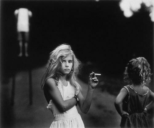 Sally Mann Photography: Sally Mann uses black and white photos, mainly of children, to comment on social borders between what is right and what in immoral in out society.