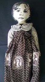Screen printed doll with appliqued South African historical women on Shwe Shwe fabric
