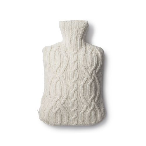 • Cream Harrison hot water bottle in a chunky cable knit design• Includes 2 litre rubber hot water bottle • Concealed zip fastening at bottom of cover • Inspired by the knitted accessories in the cabins at Soho Farmhouse• Matching eye mask, cushion, throw and slippers also available