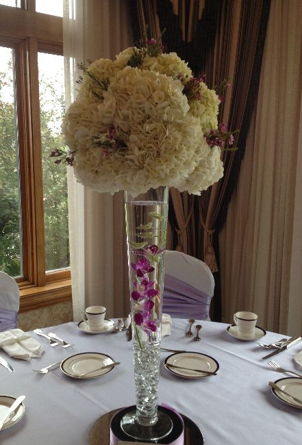 White hydrangea ball on a pilsner vase centerpieces
