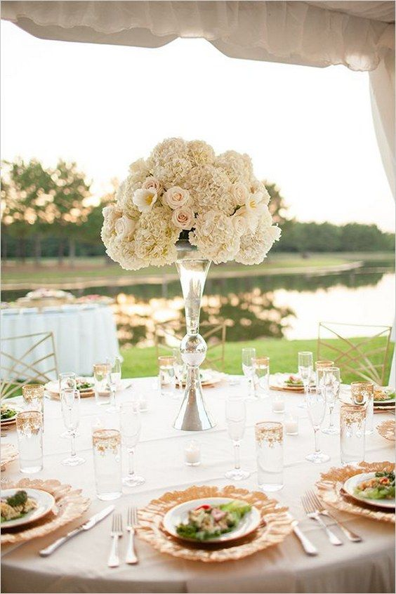 white floral wedding centerpiece / http://www.himisspuff.com/tall-wedding-centerpieces/16/
