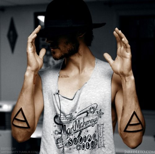 thick-line black triangles on forearms