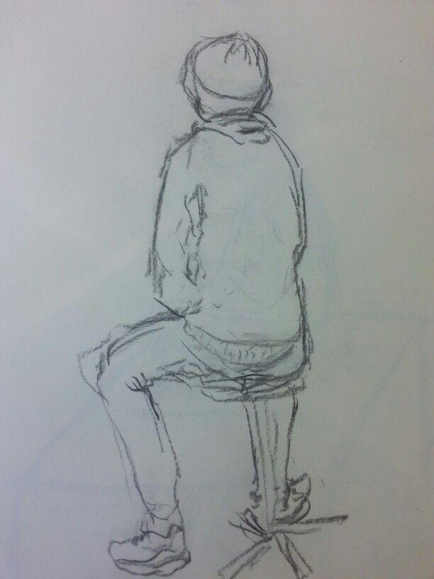 Een jongen op kruk, houtskool zwart