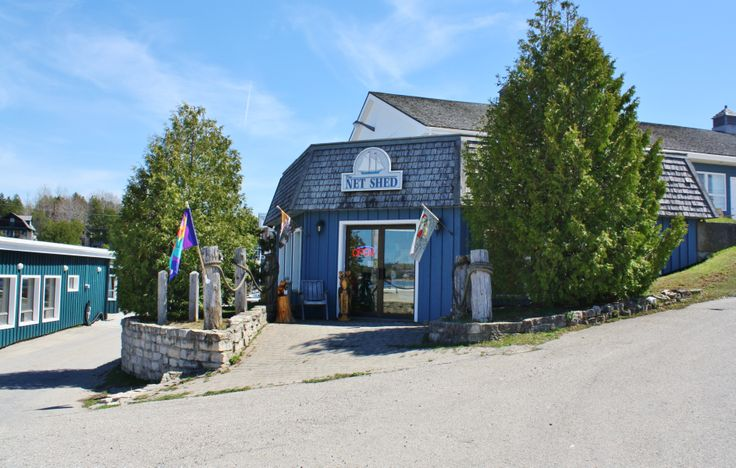 Located next to the ferry dock and below the Harbourside Motel, the Net Shed was once used by local Tobermory fisherman to repair and store their nets. Today it offers an selection of clothing and gifts home decor, a wide range of children's toys and games. The Net Shed features such brand names as Ten Tree, Wendy Tancock, Peak Time Gifts, and Manitobah Mukluks.