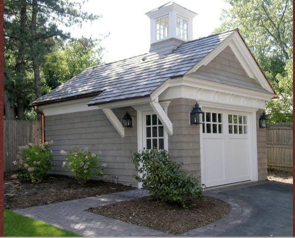 "This would be a beautiful garage or shed - minus the overhang and ""steeple""."
