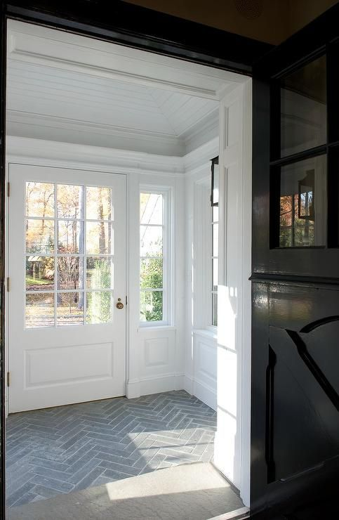 Mudroom with slate herringbone tiled floors | Brooks & Falotico