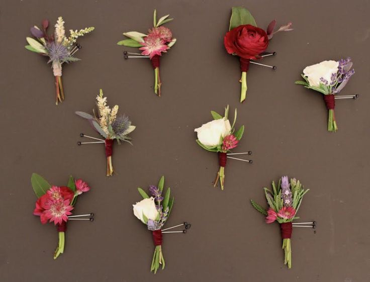 All the boutonnieres will be put together slightly differently using a mix of burgundy scabiosa flowers, fresh lavender, pale pink spray roses, pale pink astilbe, burgundy astilbe, dark pink spray roses, peachy coral hypericum berries, parvifolia eucalyptus, sage leaves and rosemary wrapped in champagne ribbon with the stems showing. www.stemfloral.com