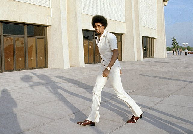 Dr. J, Julius Erving, shows off his '70s style as he enters the Nassau Coliseum before the Nets' Game 4 of the ABA Championship against the Denver Nuggets on May 8, 1976. (Manny Millan/SI) GALLERY: Rare SI Photos of Julius Erving