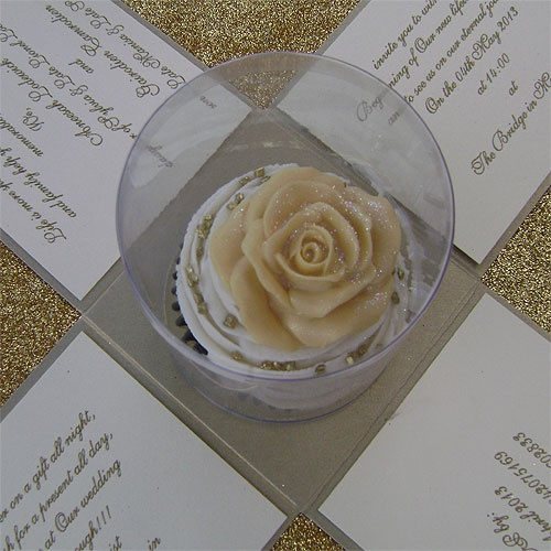 Ref Cake Boss Cup cake with rose gold ( we can do any colour) www.weddingcards.co.za