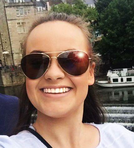 Becky wearing classic Avian sunglasses