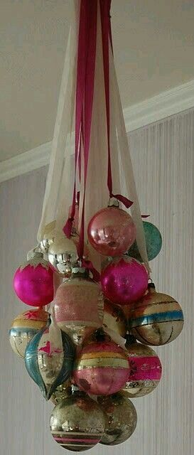 Vintage Christmas ornaments hung on ribbon to create chandelier