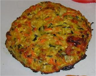 BAKED SUMMER SQUASH FRITTERS 1 large or 2 medium yellow summer squashes 1 large or 2 medium zucchinis 2 medium carrots 1 medium onion, diced 2 cloves garlic, diced or pressed ( I use a press) 1/2 cup parmesan cheese 1/4 tsp. cayenne pepper 1 tsp. Mrs. Dash or any 'table' type spice blend 1 Tbsp. olive oil 1 egg + 1 egg white