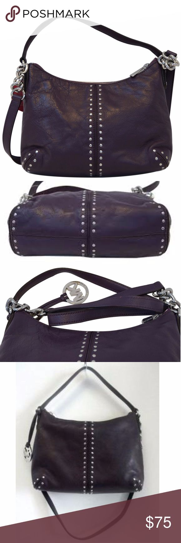 "Michael Kors Purple Leather Silver Studded Hobo Deep purple Michael Kors leather,  silver studded,  convertible hobo bag. Excellent condition.  No scratches or flaws. Ink pen stain on the interior bottom of the bag. Please see pictures.  Style: Shoulder Handbag Material: Leather Color: Purple  Size: W 12"" D 4"" H 8"" Shoulder strap drop: 35"" Michael Kors Bags Hobos"