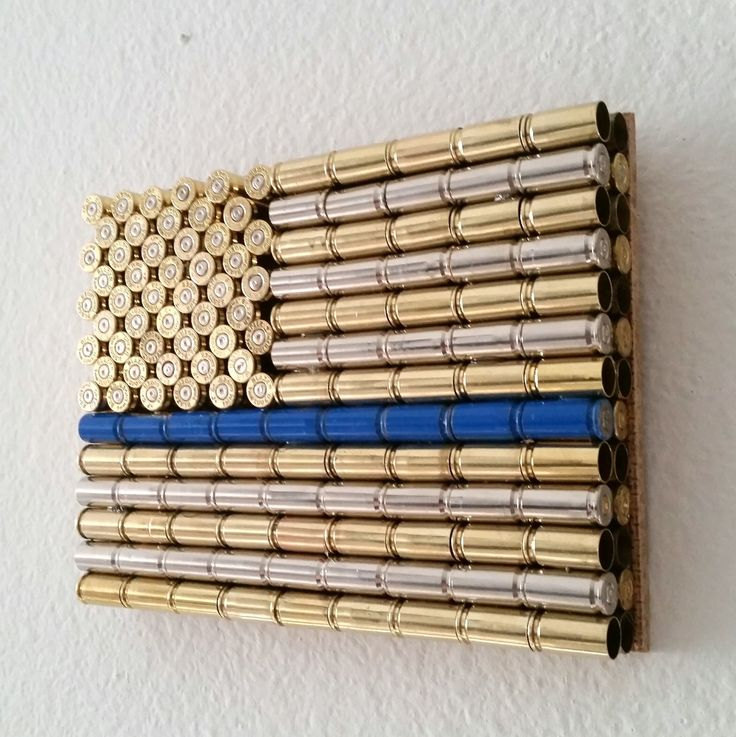 "Thin Blue Line Bullet Casing USA Flag - Metal American LEO Art. Classic Bullet Flag with a Thin Blue Line to show support to for Law Enforcement. Flag is made from recycled brass and nickel 9mm casings. Measures 6.75"" x 5"" and weighs more than two pounds. Ready to mount or display on shelf or desk."