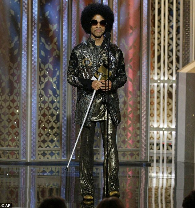 Walking stick: The Purple Rain singer wore a metallic outfit and carried a silver cane ons...