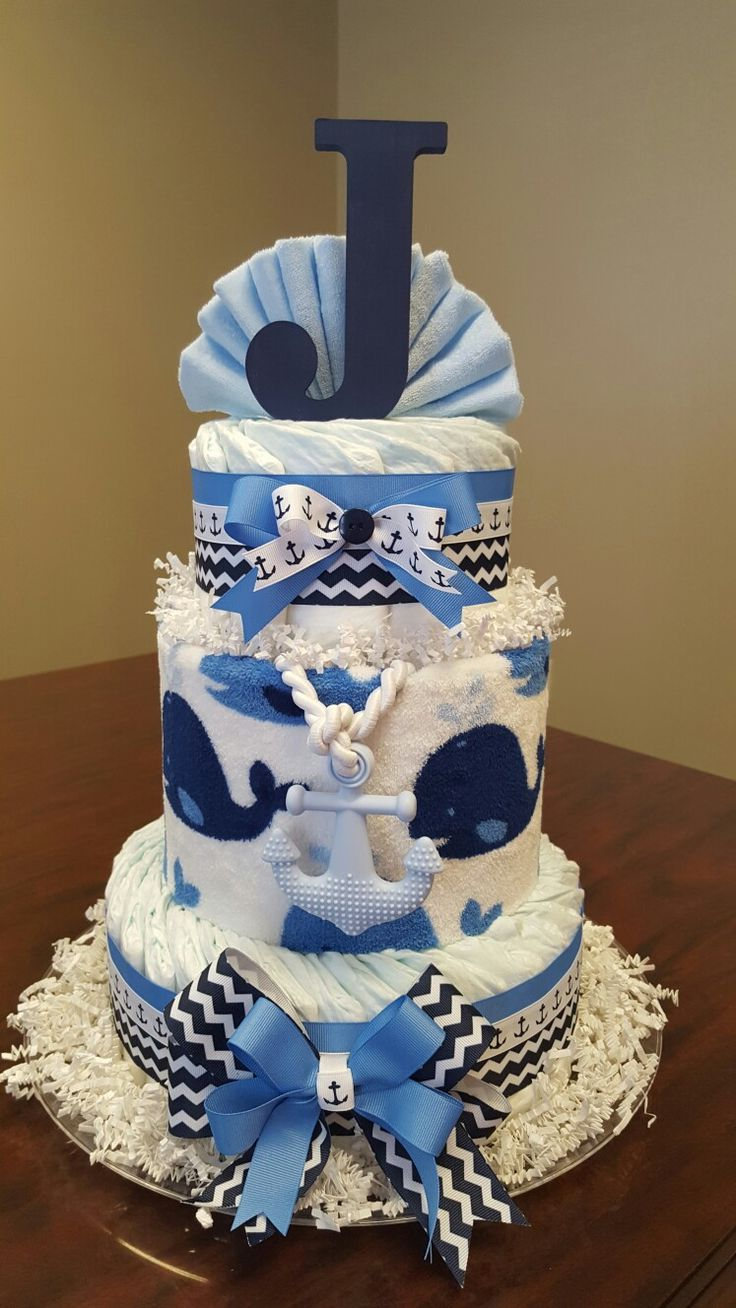 """Anchors Away"" Nautical diaper cake, includes whale blanket and anchor teether.  Check out my Facebook page Simply Showers  for more pics and orders. https://m.facebook.com/adorablegifts"