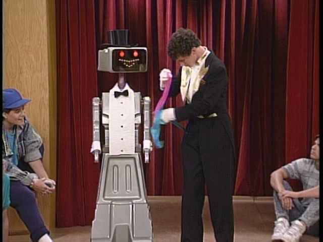 Kevin helps out Screech in the talent portion of the Miss Bayside pageant. - if someone built me a Kevin I would owe them permanently