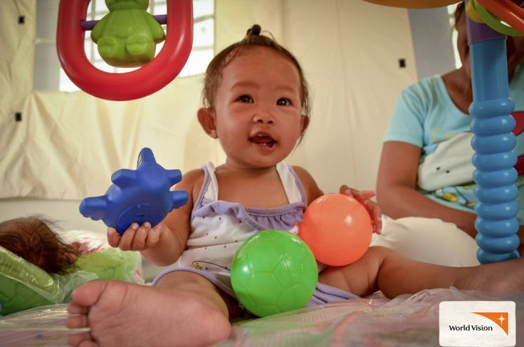 Little Solenn loved playing with the #toys at the #WorldVision #Child Friendly Space in the aftermath of #TyphoonHaiyan! Photo by Hasanthi Jayamaha, World Vision
