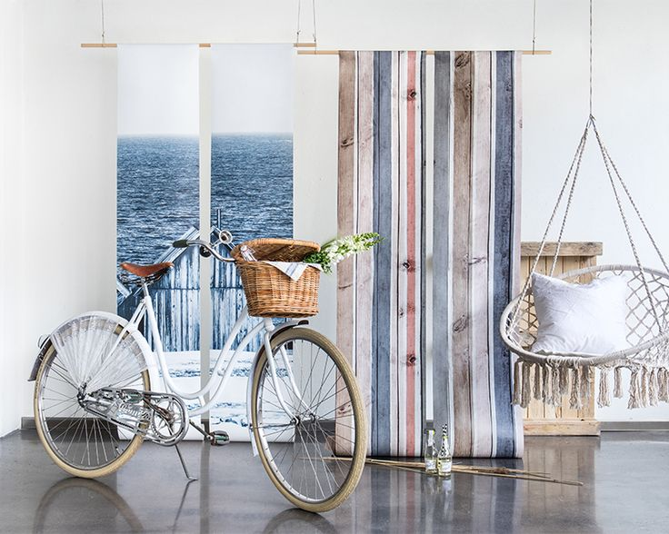 This trend collection is inspired by the natural way of living by the seaside. Included are wallpaper murals with timeless stripes, nautical motifs and soft linen textures. Enjoy a color palette of dusty pastels, warm beige, and navy blue.