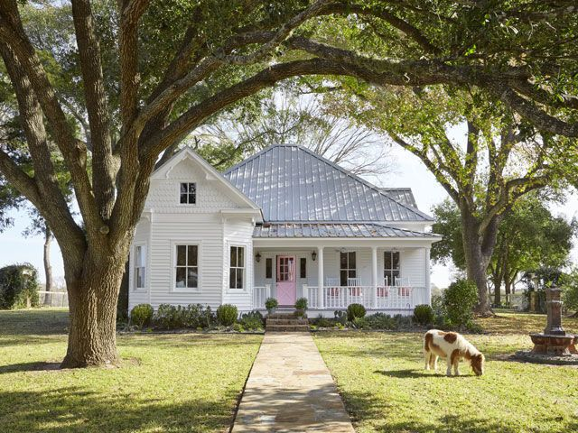 Texas white victorian farmhouse // tin roof // pink door Design by Bailey McCarthy: Country Living April 2015