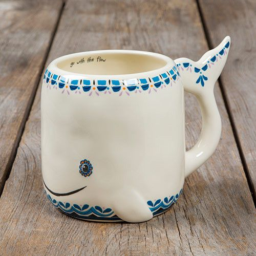 This folk art mug will have anyone smiling every time they drink from it! With an adorable whale design, they'll be reminded to 'go with the flow' each time they pick it up. Hand sculpted, ceramic mug